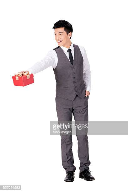 Young Businessman Holding a Gift Box