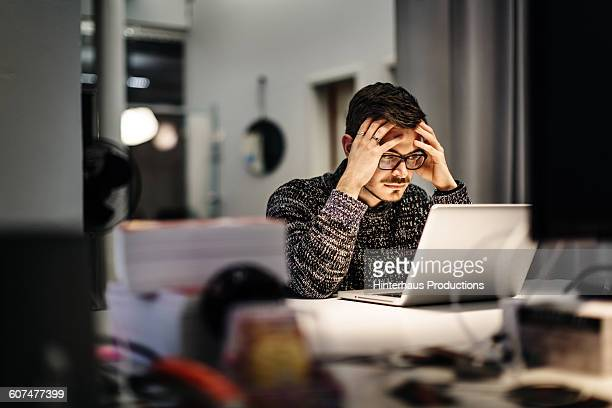 young businessman holding his head and pondering - concentration stock pictures, royalty-free photos & images