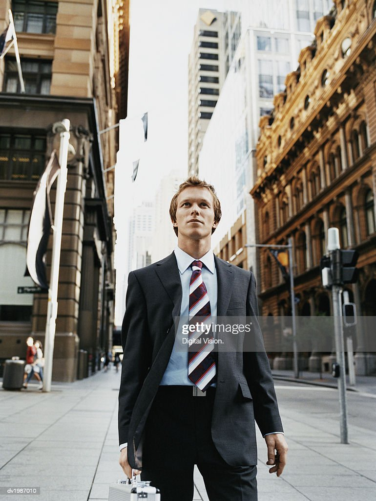 Young Businessman in a Suit Walking in an Urban Setting : Stock Photo