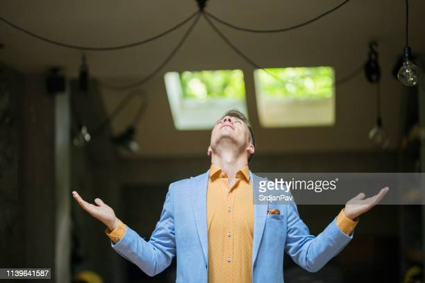 young businessman in disbelieve - multi colored suit stock photos and pictures