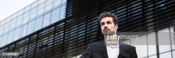 Young businessman in front of his office