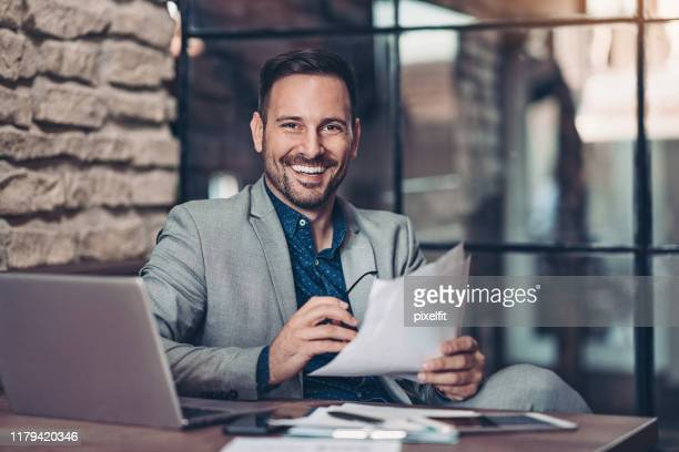 young businessman in his office - executive director stock pictures, royalty-free photos & images