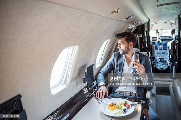 Young businessman in private jet airplane