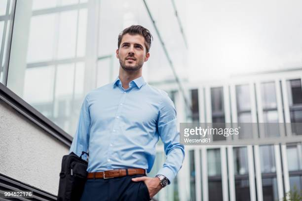 Young businessman in the city outside office building