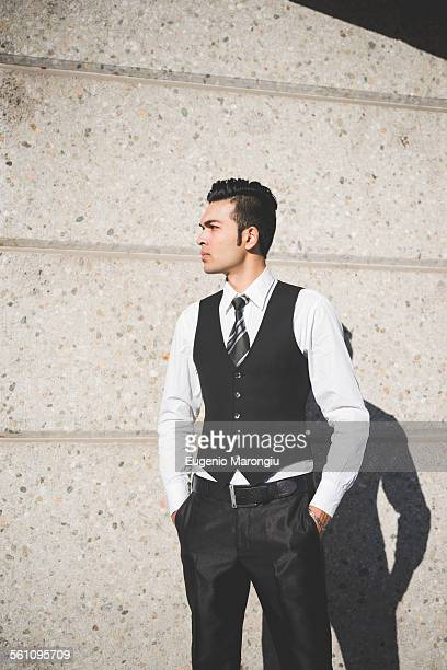 young businessman in the street, milan, italy - waistcoat stock photos and pictures