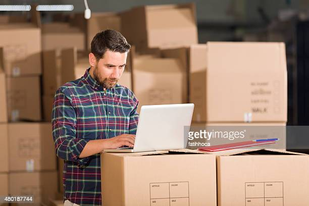 Young Businessman in Warehouse