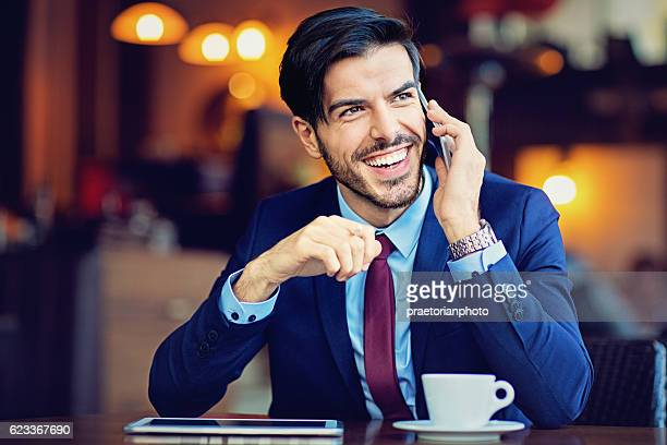 Young businessman is talking using his mobile phone
