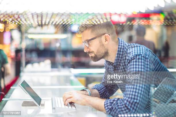 Young businessman is typing on his digital tablet