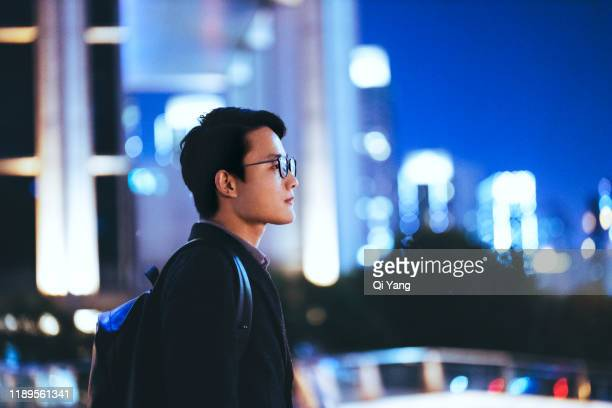 young businessman looking at beautiful shanghai night scene - defocussed stock pictures, royalty-free photos & images
