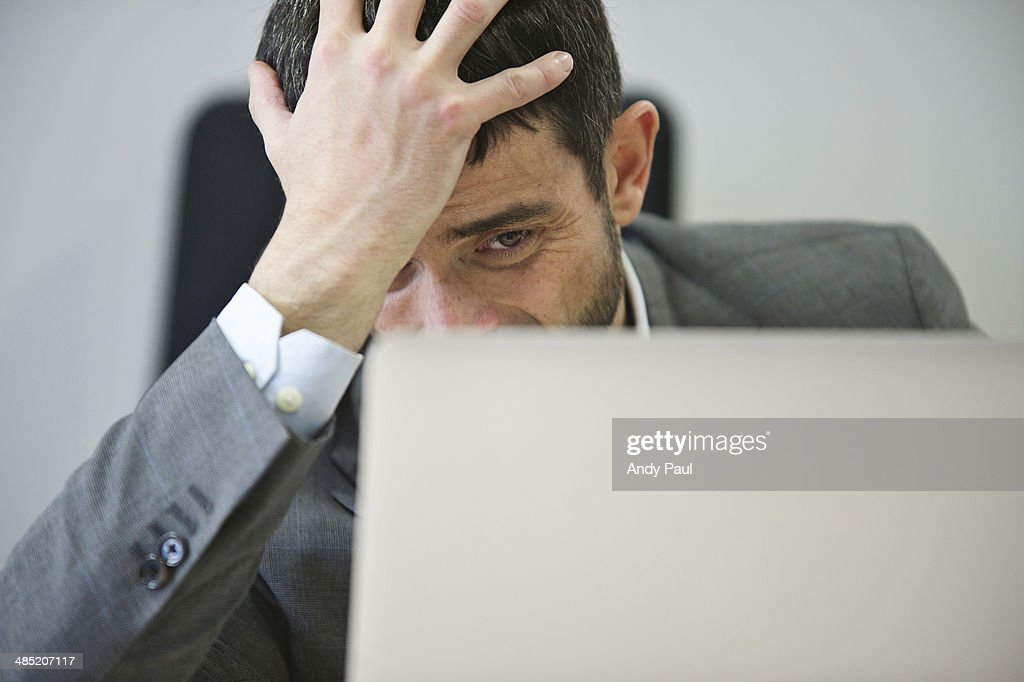 Young businessman looking stressed : Stock Photo