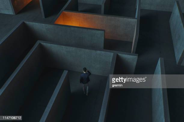 young businessman lost in maze - communication problems stock pictures, royalty-free photos & images