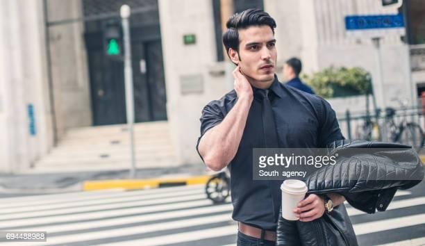 Young businessman on crosswalk