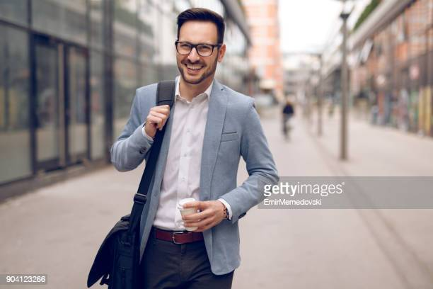 young businessman on his way to work - shoulder bag stock pictures, royalty-free photos & images
