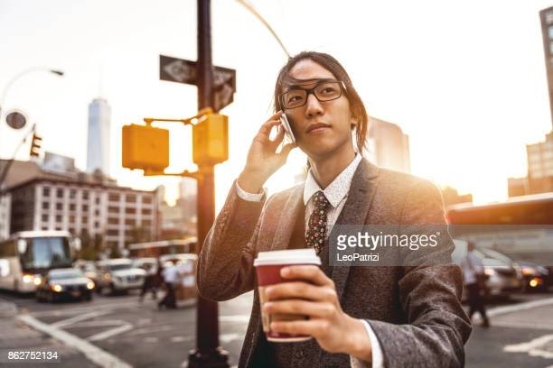 Young businessman on mobile in Soho New York