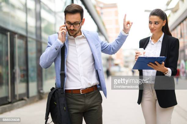 Young businessman on the phone listening to important news