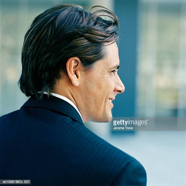 Young businessman outdoors, profile, rear view, head and shoulders