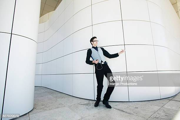 Young Businessman Playing Air Guitar