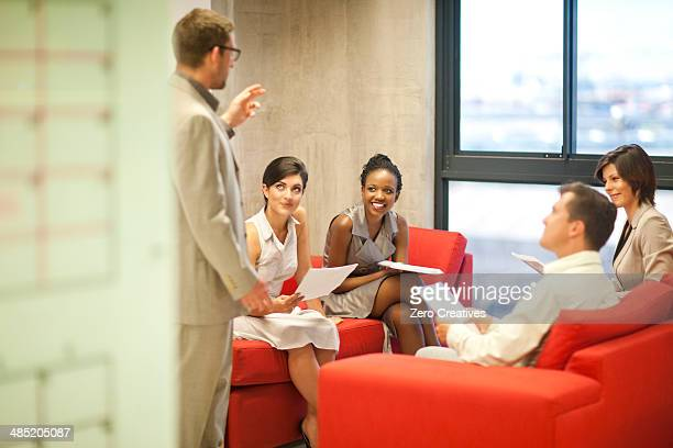 Young businessman presenting ideas to colleagues