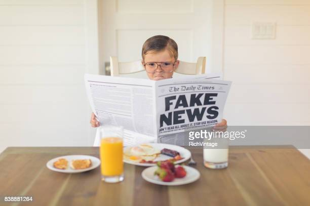 A Young Businessman Reading Fake News is Angry