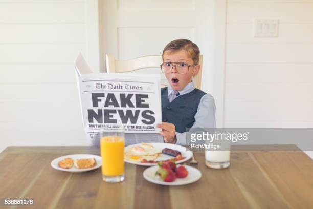 A Young Businessman Reading Fake News is Shocked