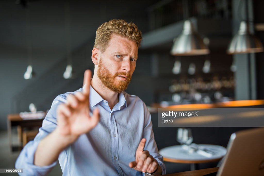 Young businessman rejecting your offer. : Stock Photo