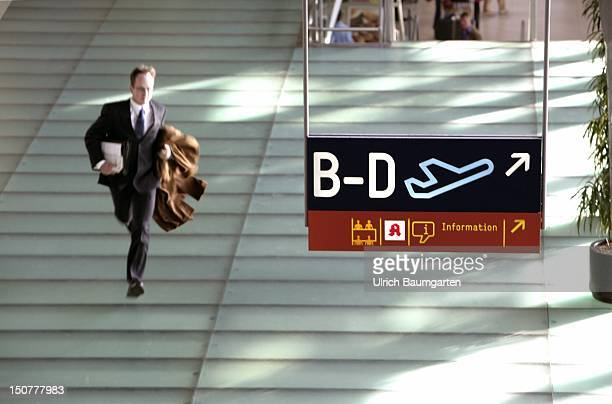 Young businessman running at the airport to his flight