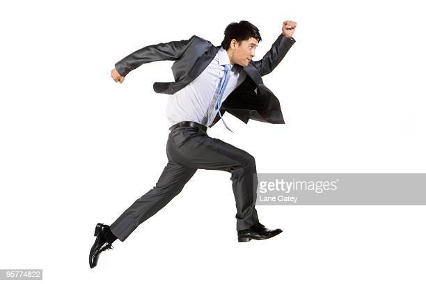 Young businessman running fast