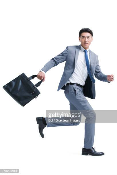 young businessman running with briefcase - 足を開く ストックフォトと画像
