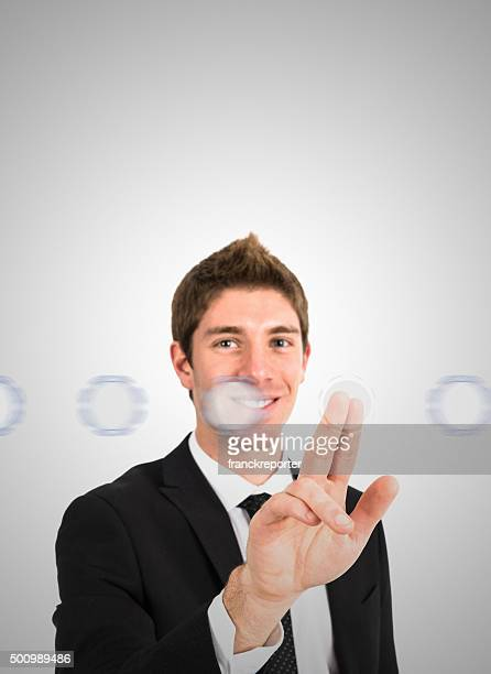 young businessman scrolling a futuristic interface