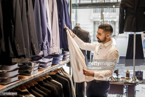 young businessman shopping - menswear stock pictures, royalty-free photos & images