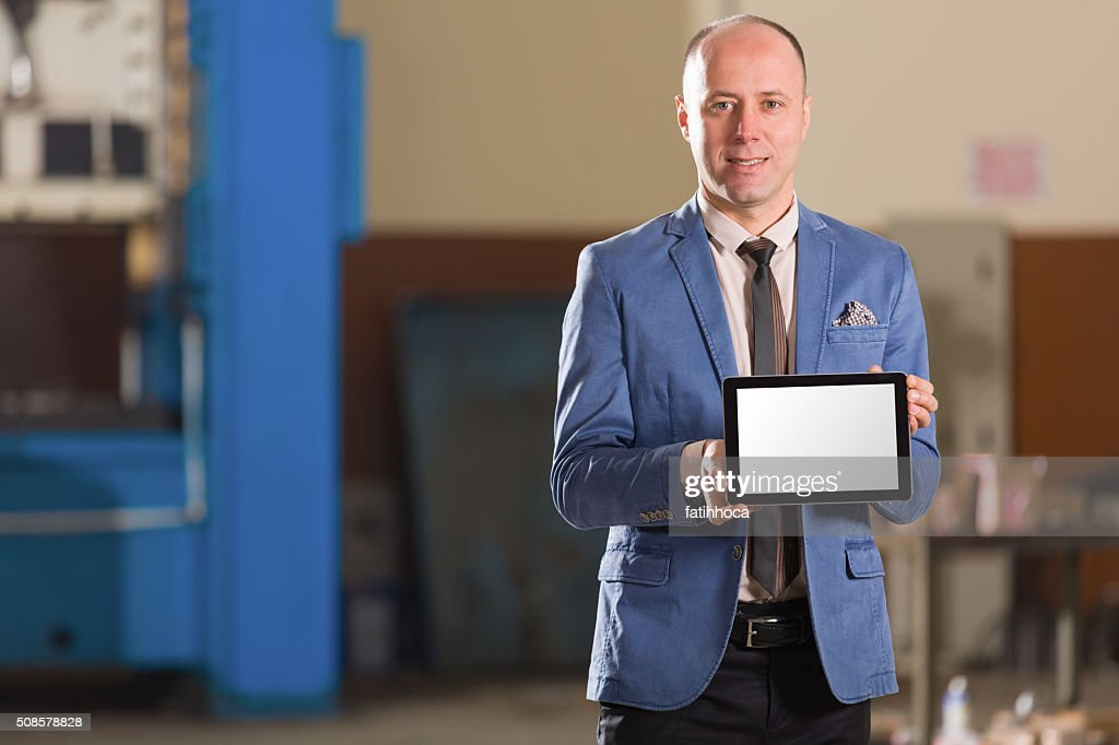 Young Businessman Showing Tablet : Stock Photo