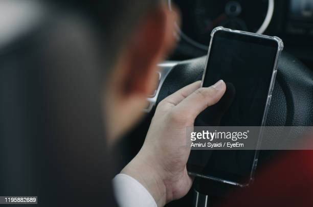 young businessman sitting in car - one man only stock pictures, royalty-free photos & images