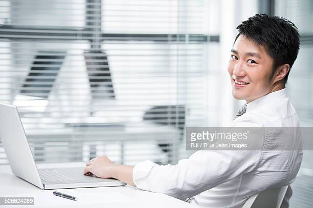 Young businessman sitting in the office