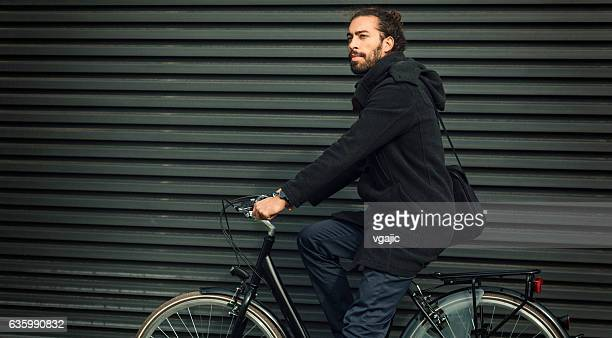 Young Businessman Sitting On Bicycle Outdoors.