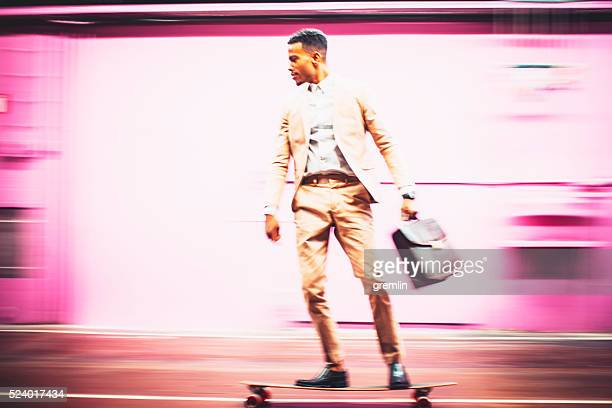 Young businessman skateboarding in offices