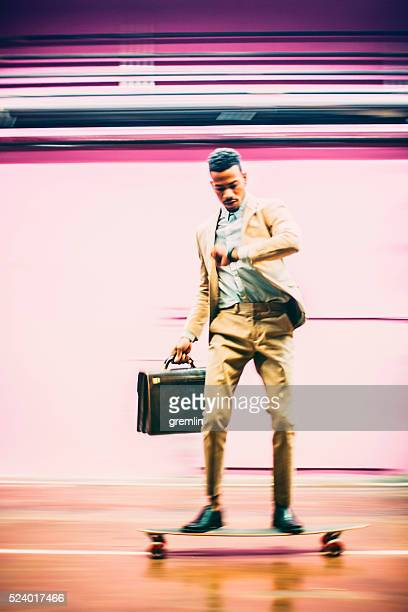 young businessman skateboarding in offices - fast fashion stock pictures, royalty-free photos & images