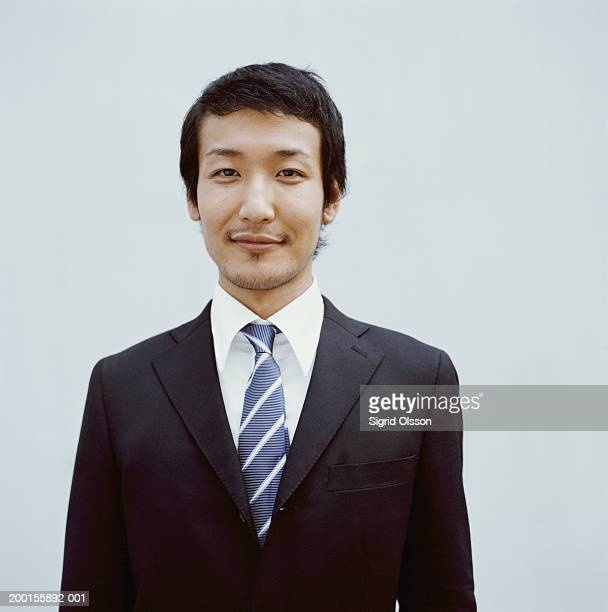young businessman smiling, portrait - striped suit stock pictures, royalty-free photos & images