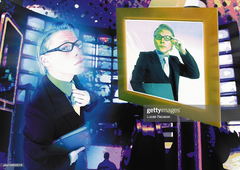 Young businessman standing in front of computer monitor, same man on screen, digital composite. : Stockfoto