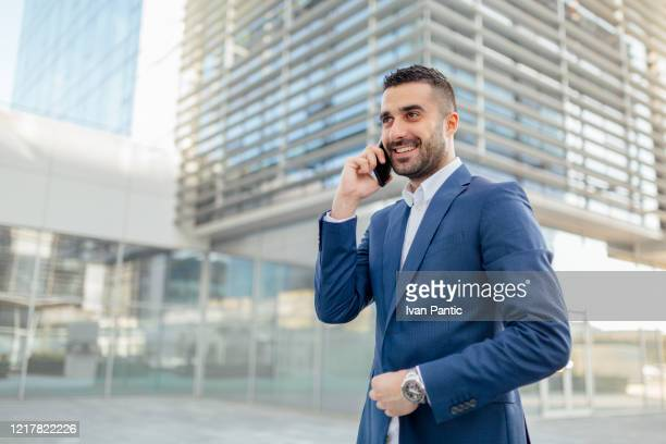 young businessman talking on the phone - managing director stock pictures, royalty-free photos & images