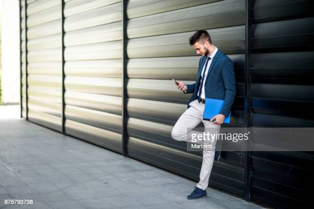 young businessman talking on the smart phone - one young man only stock pictures, royalty-free photos & images
