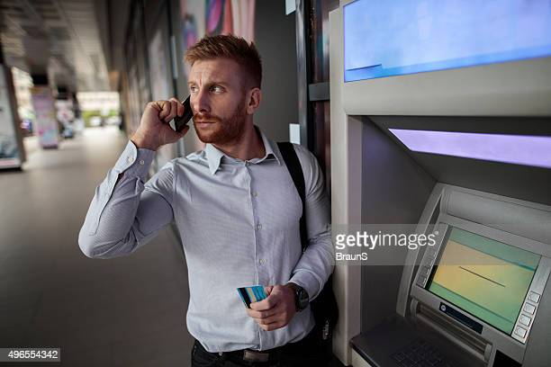 young businessman talking to someone over mobile phone. - ginger banks stock photos and pictures