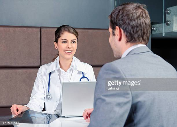 Young businessman talking with a female doctor.