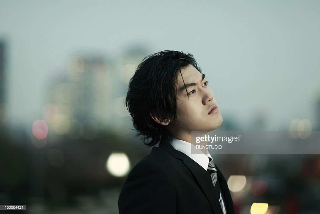 young businessman thinking : Stock Photo