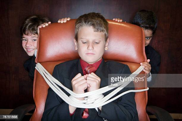 Young Businessman Tied to Chair