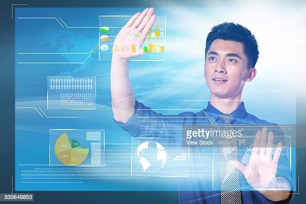 Young businessman touching screen