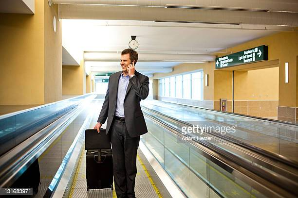A young businessman traveling in an airport.