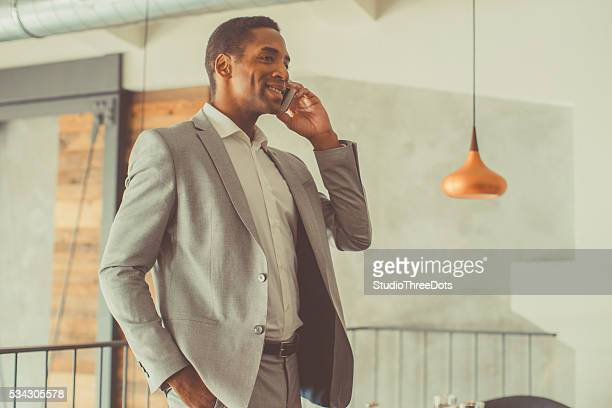 Young businessman typing on the smart phone