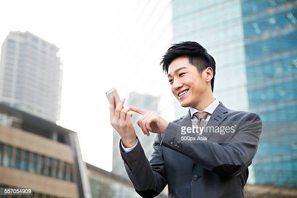 young businessman using a mobile phone - image stock pictures, royalty-free photos & images