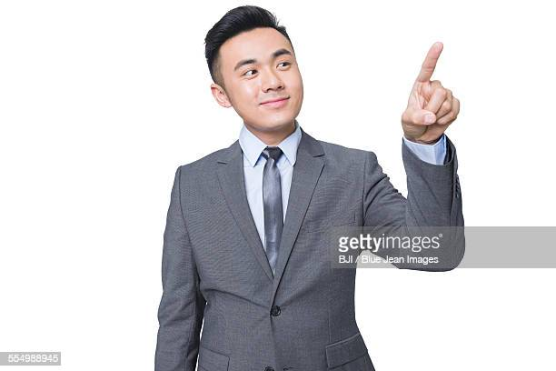 Young businessman using finger to point