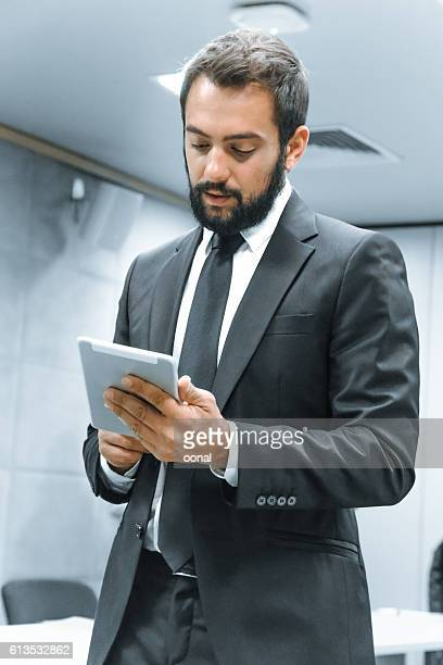 Young businessman using his tablet computer